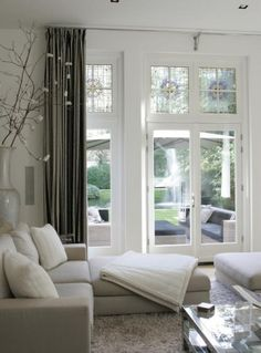 Image 11 of 30 from gallery of Interesting White Interior Doors Design Ideas. Retro white door in the interior with gray curtain plus awesome flower vase beside door then white bed sofa plus glass table above brown carpet in front of door decor idea Interior Exterior, Home Interior, Interior Decorating, Interior Design, Gray Interior, Interior Ideas, Decorating Ideas, Home Living Room, Living Spaces
