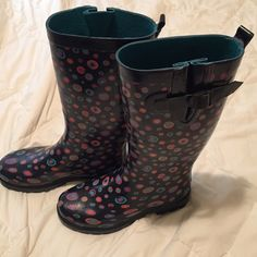 Cute polka dot rainboots ☔️ Very fun adorable rain boots! Excellent condition; only wore a few times for short increments because they're too small. They are navy with teal, purple, orange, and blue dots through out. They are conveniently adjustable at the top.  Would be a fun and practical Christmas gift!  Shoes Winter & Rain Boots