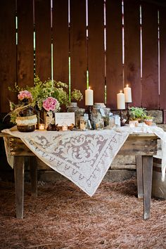 farm table and vintage lace tablecloth... Perfect for food tables. Love the way the tablecloth is off center.