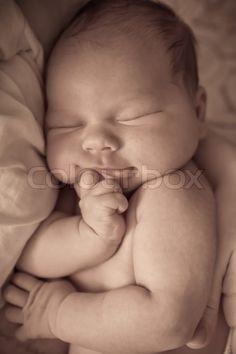 Stock image of 'Beautiful one week old baby boy asleep'