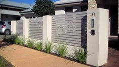 Image result for rendered brick fence with colorbond slats