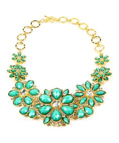 Pop goes the pretty! Flaunting faceted, color-drenched stones and shimmering Austrian crystals in a fresh floral design, this beautiful bib necklace won't be able to hide a style maven's fashionable sense of shine.