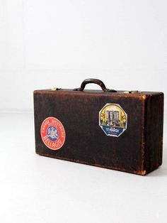 vintage suitcase with travel stickers, black leather luggage - http://oleantravel.com/vintage-suitcase-with-travel-stickers-black-leather-luggage