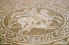 Olynthos, pebble mosaic in the dining room of House A.vi.3: Bellerophon and the Chimaira (photo by Janett Morgan)
