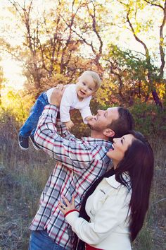 Love this pose - I like how the parents are admiring their little one, but than the little is looking right at the camera. :)  Fall  family pictures  ( family of 3 ) Cute pose  this is just plain adorable!  perfect looking family too :]