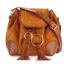 Polly suede flap bucket bag by See By Chloe. See by Chloe suede shoulder bag with fringe tassels. Pale golden hardware and leather trim. Adjustable shoulder strap...