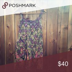 Free People One Super sweet slip dress with pockets! Loose flowy fit that's true to size. Purple lace detail around the neck hemline. Open back detail. Crinkle linen material. Free People Dresses Midi