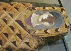 Mummy of a young woman. Egypt, Roman Period. From Fayoum. Circa 2nd Century AD. Painted portrait panel mounted over the mummy's face. ...