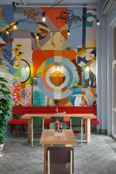 A vibrant and eclectic 65-seater diner in Kiev, Ukraine that serves Asian street food, Kitaika designed by AKZ Architectura was inspired by street culture in Asia and Ukraine. Combining carnival-like elements, bold colors, garlands of exposed light bulbs, and eye-catching graffiti, this little diner is a surreal and delightful take on Asian dining.