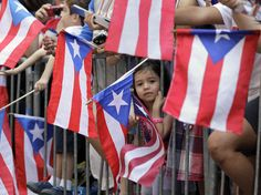 Boricua Rico Puerto Rican | People wave Puerto Rican flags at the National Puerto Rican Day parade ...