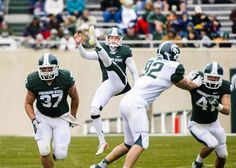 ddb7fdfcb MSU green team punter Mike Sadler (center) watches a punt in the 2nd quarter