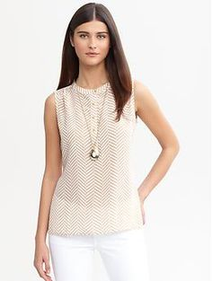 Style Note: Try a shirt like this tucked into your ruffled black ankle-length skirt. May fall nicely untucked as well. (Chevron silk buttoned tank | Banana Republic)