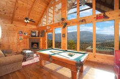 Floor-to-ceiling windows are always a must when it comes to mountain homes. In this Great Smoky Mountain cabin (appropriately named 'Alone with a View') is able to showcase the rolling mountain landscapes, offer plenty of natural lighting, and help guests to feel like they're in the great outdoors while sitting in the living room. It's the perfect mountain escape! #GreatSmokyMountains #Tennessee #mountainhome #rusticelegance #shabbychic #mountaincabin #interiordesign