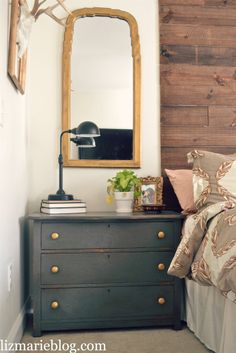 I like the idea of using a small dresser where the nightstand would normally be. Probably a  much better use of space