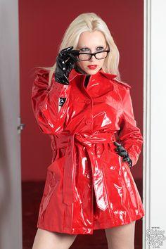 Blonde in pvc raincoat