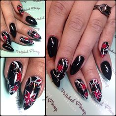 Hand painted red and white flowers on black nails to make them Christmassy!!