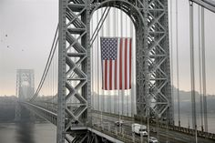 The largest free-flying American flag in the world flies over the George Washington Bridge on Sept. 2 in Fort Lee, N. The flag was flown on Labor Day to honor working men and women across the country. The flag is 90 feet long by 60 feet wide. I Love America, God Bless America, Ansel Adams, New Jersey, Jersey Girl, A Lovely Journey, Flying Flag, A New York Minute, Independance Day