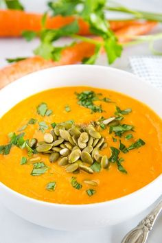 Carrot Ginger Soup – Smooth and creamy carrot soup with ginger, turmeric, garlic, and chicken broth.  Healthy, comforting, and and the perfect way to brighten up a cold day! As soon as the weather gets cold I am all about soup. I am pretty sure that Creamy Wild Rice Soup might be my all time … Butternut Squash Soup Creamy, Creamy Carrot Soup, Carrot Ginger Soup, Indian Lentil Soup, Ginger Soup Recipe, Soup Recipes, Dinner Recipes, Cooked Carrots, Wild Rice Soup