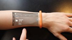 A tiny new wristband can project a tablet interface onto your arm, effectively turning it into a smartphone every time you twist your wrist.
