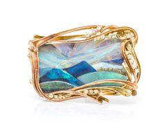 * A 14 Karat Gold, Opal Mosaic and Diamond 'Sunset over Bali' Brooch, Angel