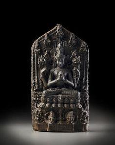 A blackstone stele of Avalokiteshvara Shadakshari Bihar, Pala period, 11th/12th century 12 in.