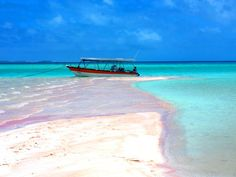 "A string of hundreds of islets surround a sizable lagoon to form Rangiroa, one of the largest atolls in the world. While remote, it is serviced by regular flights from Tahiti. The deserted, blush-colored beach is called Les Sables Roses, or ""the Pink Sands."""