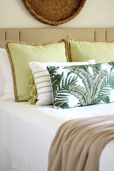 Black, White & Glam : Laid Back Tropical Vibes | House Full of Summer - green throw pillows, natural textures, Florida guest room, neutral guest room decor, vintage rug, tassel pillows, beach house lumbar pillow, under $20, gold leaf decorative accents, tropical decor, coastal bedroom design, candle holder, woven striped baskets, Christmas Tree Shops andThat! Jacksonville, FL #parternship #EverySeasonEveryReason #andthat Decorating On A Budget, Porch Decorating, Tropical Decor, Tropical Vibes, Discount Home Decor, Green Throw Pillows, Guest Room Decor, Pinterest Home, Coastal Homes