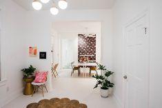 Before & After: A Drab Studio Becomes A Fresh Backdrop for Vibrant Floral Artwork – Design*Sponge Flat Files, Floral Chair, Studio Spaces, Studio Kitchen, Floral Artwork, White Shelves, Painting Studio, Large Painting, Artwork Design