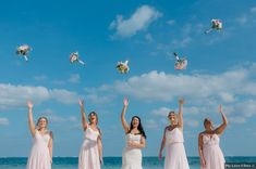 Bridesmaid tossing bouquets in the air, beach bridesmaid photography