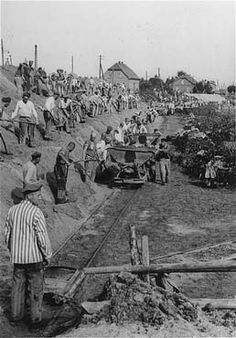 Dove-Elbe project. Neuengame concentration camp prisoners dig a canal so the SS can ship supplies down to the Elbe River,in 1940.the camp was built in 1938