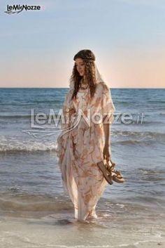 http://www.lemienozze.it/operatori-matrimonio/vestiti_da_sposa/daniela_gristina/media/foto/15  Abito da sposa stile kimono a fantasia
