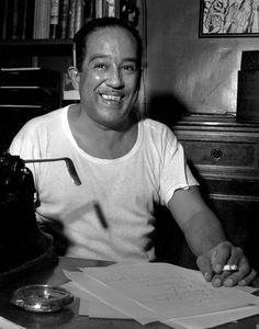 """Fred Stein Langston Hughes, New York City 1954 """"Books -where if people suffered, they suffered in beautiful language, not in monosyllables, as we did in Kansas."""" Langston Hughes, """"I Wonder as I Wander: An Autobiographical Journey"""" 1956"""