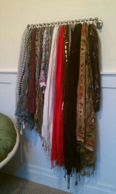 Use a towel rack and shower hooks for scarf and belt storage