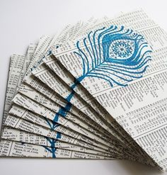 handcrafted envelopes made of upcycled paper ... luv the stamping on the book paper ... available on Etsy ...
