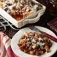 Baked Ziti: aka whatever pasta you have in the pantry :) Made this tonight with what I had on hand. Used beef broth instead of wine. 28 oz. can whole San Marzano tomatoes, crushed by hand. Only three links spicy Italian sausage. No eggplant or olives. Yummy. Family loved it, even the baby!