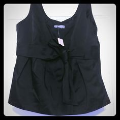 FLASH SALE Sleeveless top New Ann Taylor black pleated bow sleeveless top with zip closure on the side. Pair with a black pencil skirt and your set to go. Ann Taylor Tops