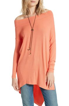 Designed to drape off your shoulder and swing around your frame, this coral stretch-knit tunic has a steep side slit that makes it both comfy and a little flirty.