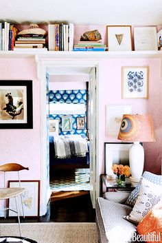 6 Ideas For Decorating a One-Bedroom // pink, living room, books