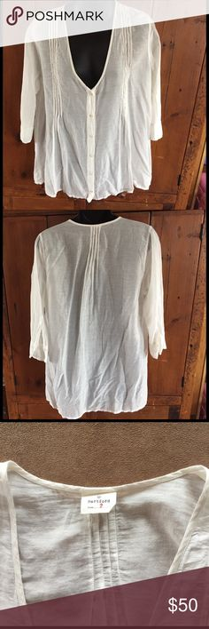 Hartford White Sheer Pleated 3/4 Sleeve Top Size 2 Hartford White Sheer Pleated 3/4 Sleeve Top Size 2. Light weight v-neck button blouse. Beautiful fabric and super soft! Sheer fabric as pictured. Tiny stain on shoulder-see picture. Otherwise in good condition. Please ask questions! Hartford Tops Blouses