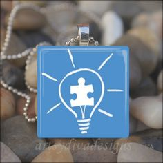LIGHT UP BLUE Autism Awareness World Autism Day Glass Tile Pendant Necklace Keyring. $9.99, via Etsy.