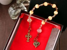 Pocket Prayer Chaplet Golden Wooden and Swarovski Crystal Beads with Antique Gold Finish Detailed Heart and Cross Charms in Velvet Pouch Swarovski Crystal Beads, Etsy Crafts, Golden Color, As You Like, Antique Gold, Gift Tags, Prayer, Charms, Handmade Jewelry
