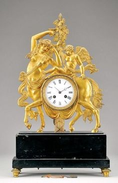 Brass table clock with mythological theme, mounted on black marble. French movement dating from the 19th c.