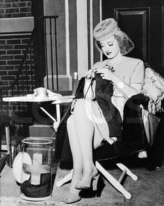 Bette Davis knits sweaters for the Red Cross on the set of Warner's In This Our Life (1942 )