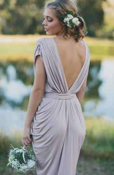 Godiva Gown. A beautifully draped cocktail dress by Nicolangela. Features a v-neckline and detachable belt sash. #whiterunway #weddingflash #weddingfashion #bridesmaids