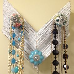 Necklace holder with frame corner and drawer pulls from Anthropologie.