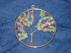 My version of the Tree of Life - JEWELRY AND TRINKETS  Now I know what to do with those bracelets..... Wire Wrapped Jewelry, Wire Jewelry, Jewelry Crafts, Tree Of Life Jewelry, Tree Of Life Pendant, Craft Tutorials, Craft Projects, Craft Ideas, Wire Trees