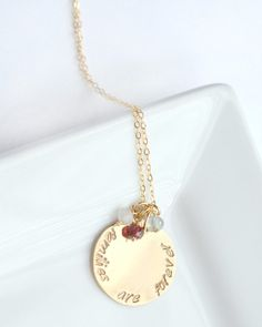 Gold custom necklace 'Families are forever' gold disc accompanied by the birthstones for each member of your family.  You can choose the number of birthstones. Beautiful gift for mom!