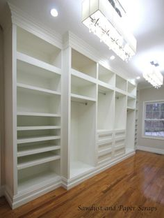 Master Closet with white built-in wardrobes
