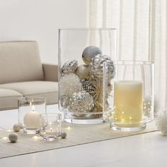 Taylor Glass Hurricane Candle Holders - remember to try with twinkle lights in vases, etc. Magical Christmas, Silver Christmas, Christmas Home, Nordic Christmas, Modern Christmas, Christmas Centerpieces, Xmas Decorations, Winter Home Decor, Diy Home Decor