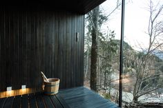 Forest Sauna at MIRAMONTI Boutique Hotel with a view. Dark Hemlock wood and Swedish black oil.